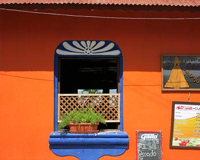 flores guatemala blue orange house