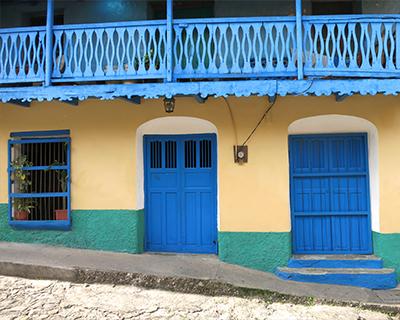 guatemala flores blue yellow house
