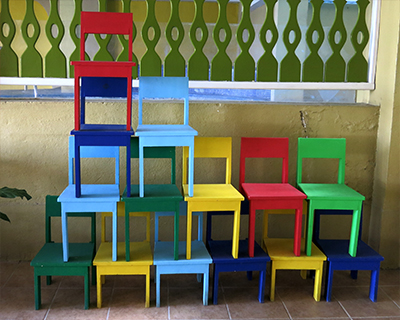 guatemala flores bright colored chairs