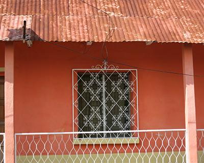 guatemala flores peach colored house