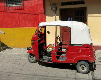 guatemala flores red bajaj taxi