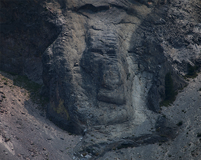 crater lake rocks look like faces