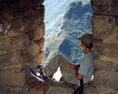 child looking out from machu picchu